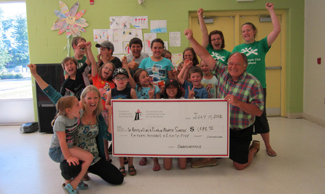Large cheque presentation to the Boys and Girls club for $1585 from the Unrestricted community fund