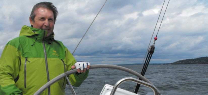 Image of Butch in his green jacket on board his boat in Georgian Bay