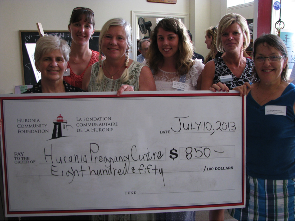 Six women standing behind a very large cheque made out the the Huroia Pregnancy Centre for $800