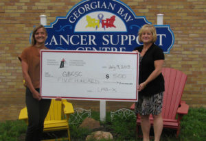 Presentation of large cheque to the Cancer support centre from the Lab-X Media fund