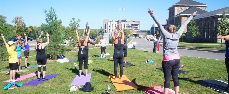 A group of women doing yoga outside