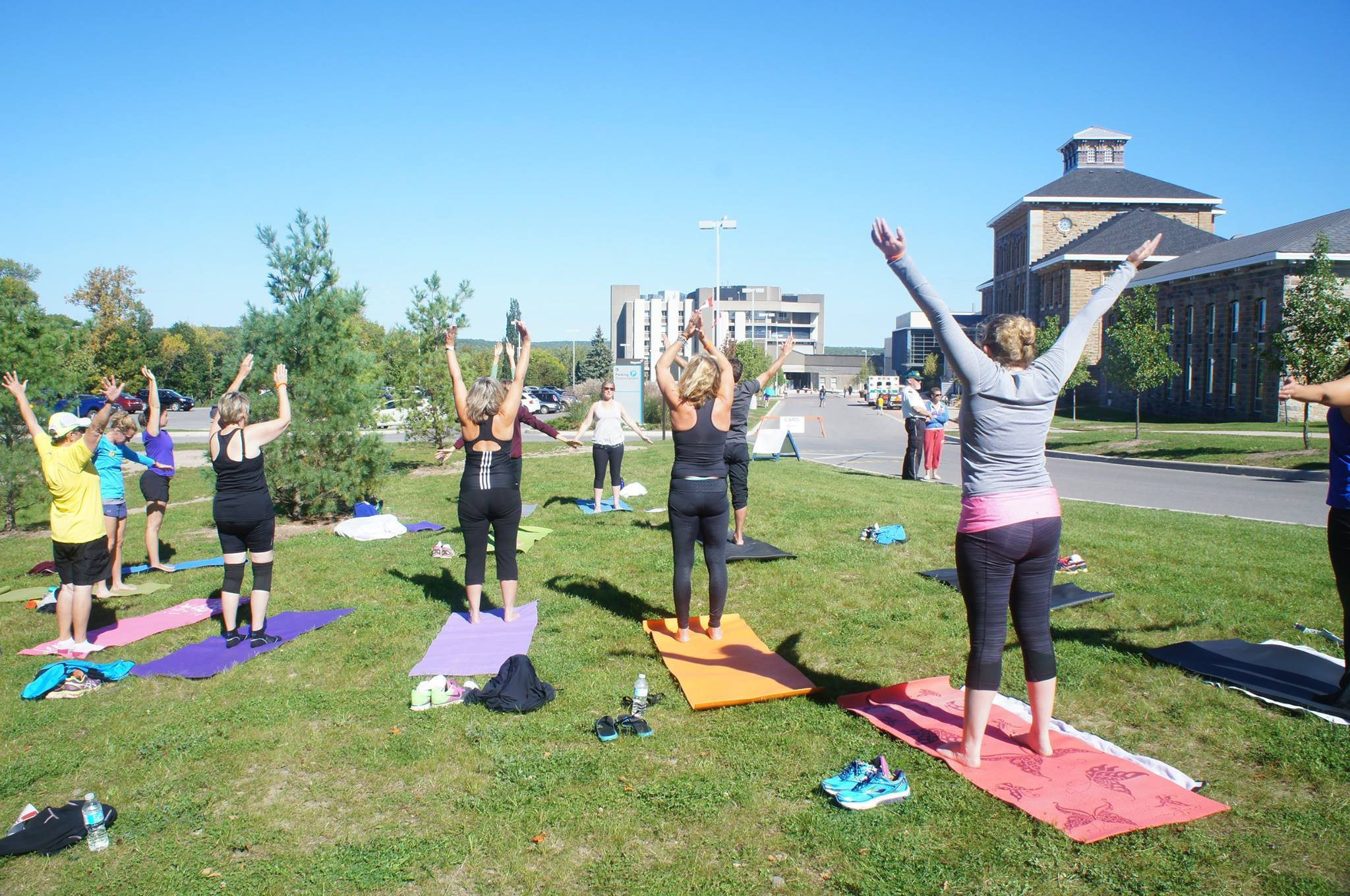 A group of women doing yoga outside